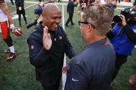 Cincinnati Bengals special assistant Hue Jackson, left, meets with Cleveland Browns head coach Gregg Williams, right, in the second half of an NFL football game, Sunday, Nov. 25, 2018, in Cincinnati. (AP Photo/Gary Landers)