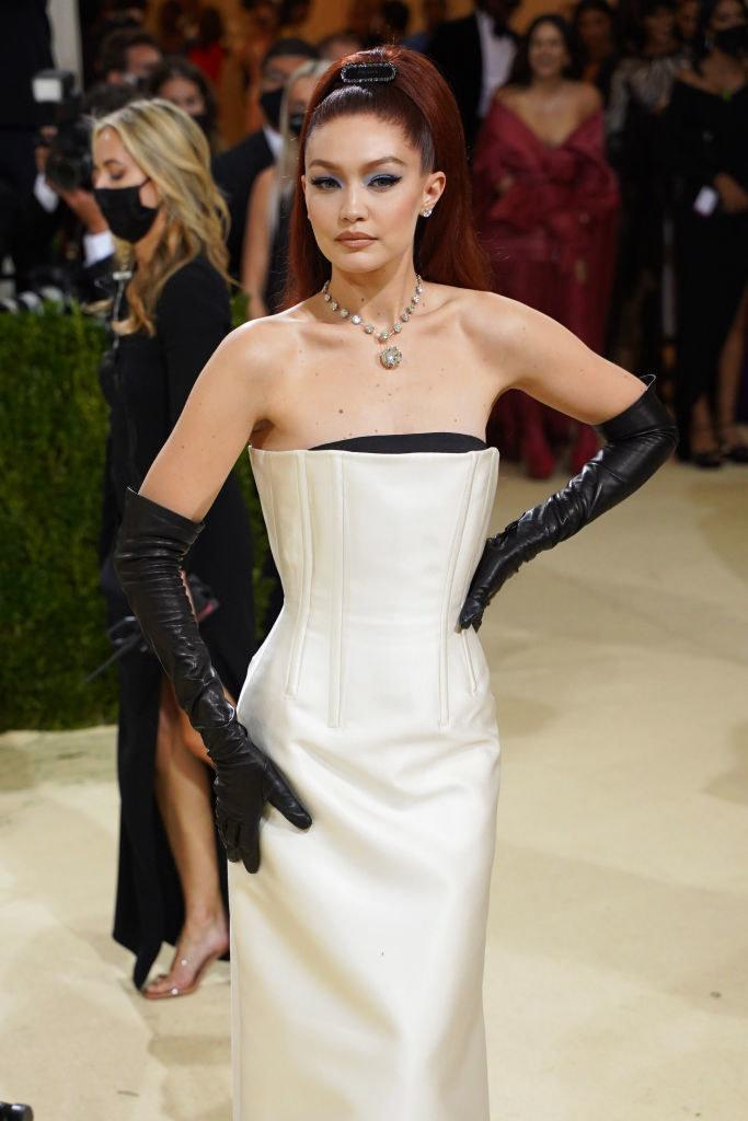Gigi wore a strapless gown with a structured bodice and gloves