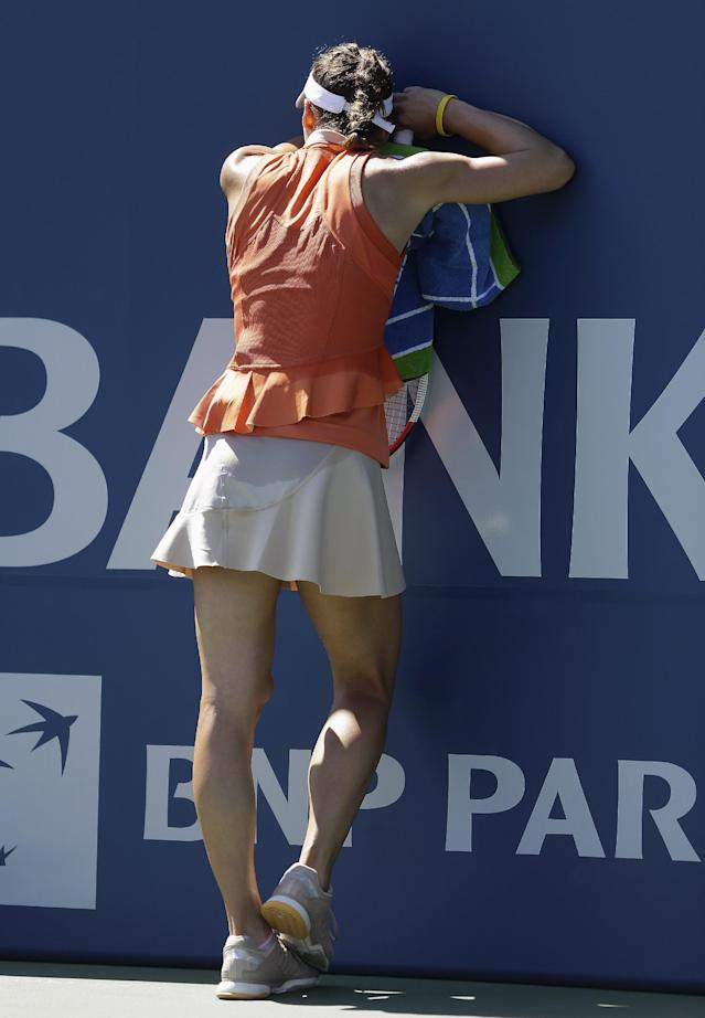 Andrea Petkovic, from Germany, rests against the wall after winning a point against Serena Williams, of the United States, during the second set of a semifinal in the Bank of the West Classic tennis tournament in Stanford, Calif., Saturday, Aug. 2, 2014. Williams won 7-5, 6-0. (AP Photo/Jeff Chiu)