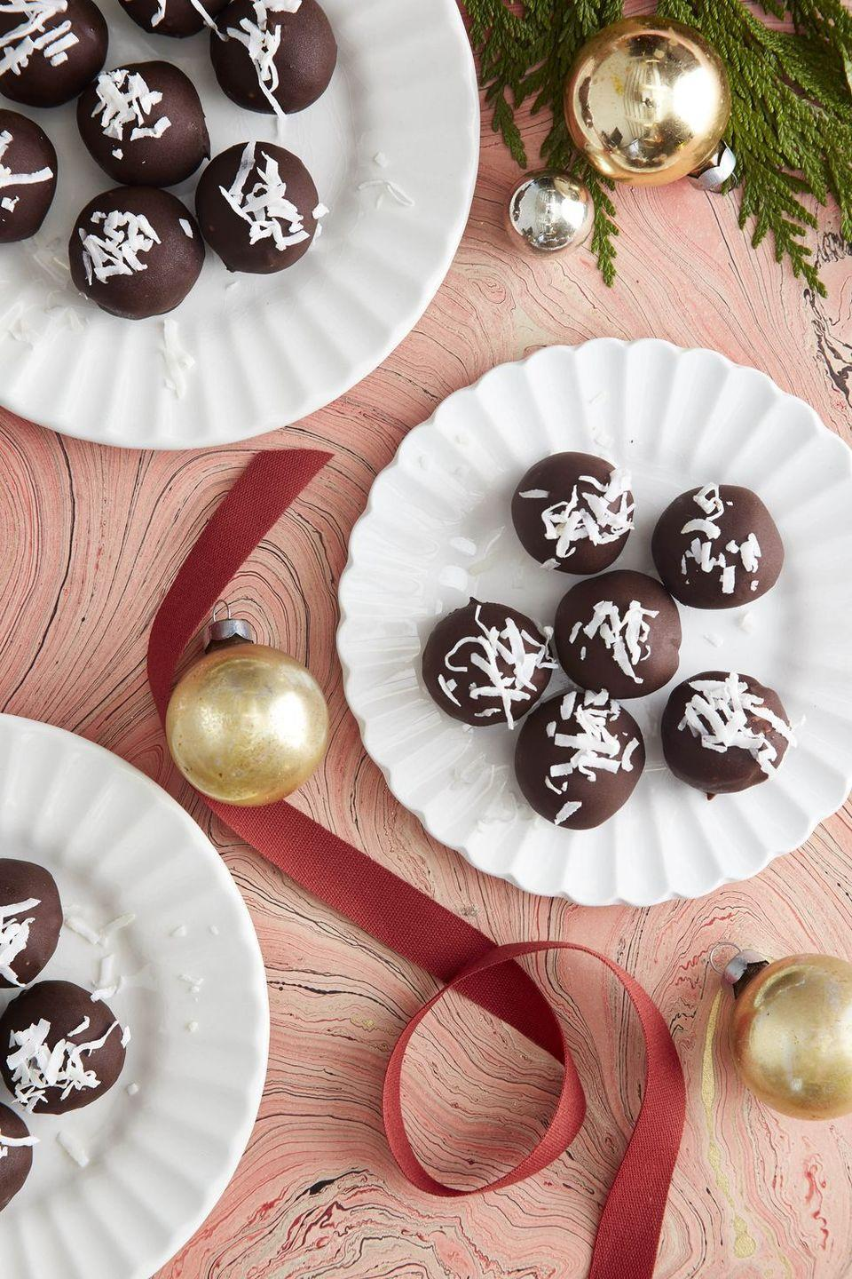 """<p>Who can say no to truffles? </p><p><strong><a href=""""https://www.countryliving.com/food-drinks/a34373834/chocolate-coconut-truffles-recipe/"""" rel=""""nofollow noopener"""" target=""""_blank"""" data-ylk=""""slk:Get the recipe"""" class=""""link rapid-noclick-resp"""">Get the recipe</a>.</strong></p>"""