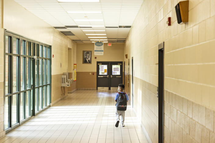 A student makes his down a hallway during summer school at Ida Green Elementary. (Brad Vest / for NBC News)