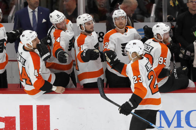 Philadelphia Flyers' Oskar Lindblom (23) celebrate his goal with teammates during the first period of an NHL hockey game against the Chicago Blackhawks on Thursday, Oct. 24, 2019, in Chicago. (AP Photo/Charles Rex Arbogast)