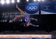 <p>Team USA's Simone Biles does what she does best, flying high on the balance beam during the women's gymnastics qualifying round on July 25. </p>