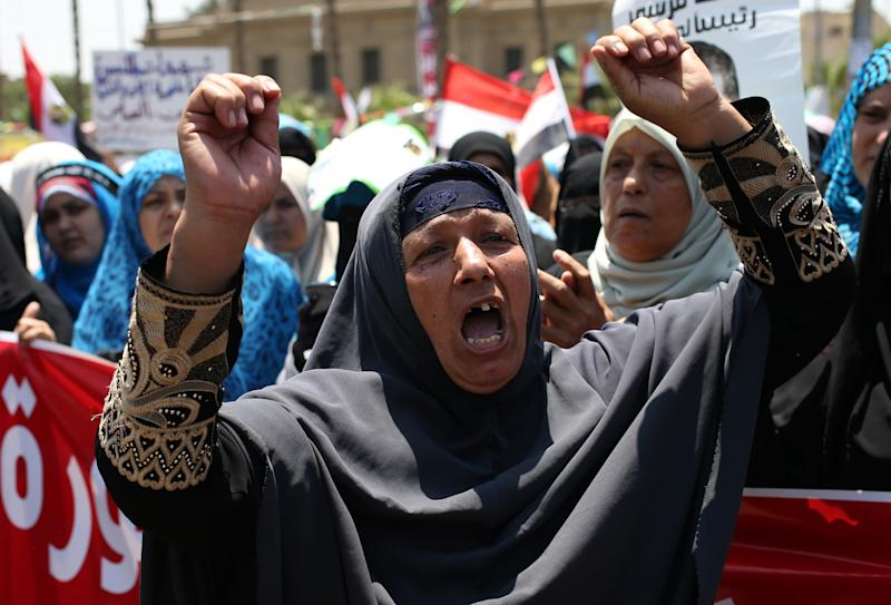 A supporter of ousted Egyptian President Mohammed Morsi shouts slogans during a demonstration in front of the National Council for Human Right building in Cairo, Egypt, Sunday, July 21, 2013. Clashes between protesters and security forces have erupted into violence several times since Morsi's ouster, killing more than 60 people. The most recent incident occurred Friday night in the Nile Delta city of Mansoura when unidentified assailants opened fire at a Brotherhood-led march, sparking a melee that killed three female protesters, authorities said. (AP Photo/Hussein Malla)