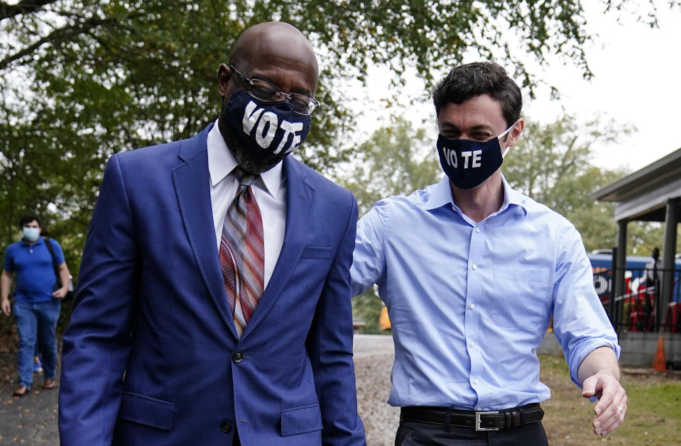 Jon Ossoff, right, and Raphael Warnock, left