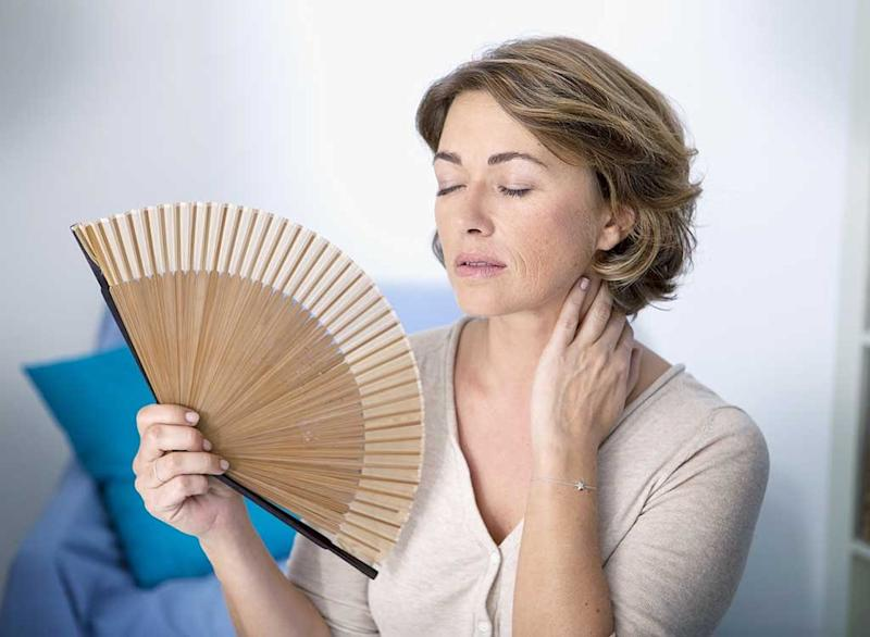 menopausal woman experiencing hot flash
