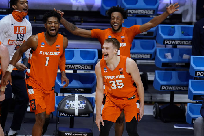 Syracuse's Quincy Guerrier (1), Buddy Boeheim (35) and Alan Griffin celebrate a teammate's 3-point shot late in the second half against San Diego State in a college basketball game in the first round of the NCAA men's tournament at Hinkle Fieldhouse in Indianapolis, Friday, March 19, 2021. (AP Photo/AJ Mast)
