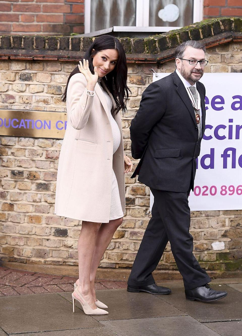 "<p>Meghan visited Mayhew, a grass-roots animal charity, and one of her new royal patronages, in London <a href=""https://www.townandcountrymag.com/style/fashion-trends/a25906832/meghan-markle-mayhew-cream-hm-dress-photos/"" rel=""nofollow noopener"" target=""_blank"" data-ylk=""slk:wearing an affordable cream-colored"" class=""link rapid-noclick-resp"">wearing an affordable cream-colored</a> maternity <a href=""https://www2.hm.com/en_us/productpage.0669953003.html?"" rel=""nofollow noopener"" target=""_blank"" data-ylk=""slk:dress from H&M"" class=""link rapid-noclick-resp"">dress from H&M</a> with a cashmere Armani coat and nude heels.</p><p><a class=""link rapid-noclick-resp"" href=""https://go.redirectingat.com?id=74968X1596630&url=https%3A%2F%2Fwww2.hm.com%2Fen_us%2Fproductpage.0669953003.html&sref=https%3A%2F%2Fwww.townandcountrymag.com%2Fstyle%2Ffashion-trends%2Fg3272%2Fmeghan-markle-preppy-style%2F"" rel=""nofollow noopener"" target=""_blank"" data-ylk=""slk:SHOP NOW"">SHOP NOW</a> <em>H&M Mama Fine-Knit Dress, $34.99</em></p>"