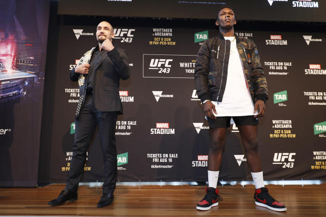 Robert Whittaker (L) and Israel Adesanya (R) pose during a UFC 243 press conference at Federation Square on Aug. 15, 2019, in Melbourne, Australia. (Getty Images)