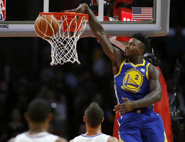 Golden State Warriors forward Jordan Bell dunks against the Los Angeles Clippers. (AP Photo/Ryan Kang)