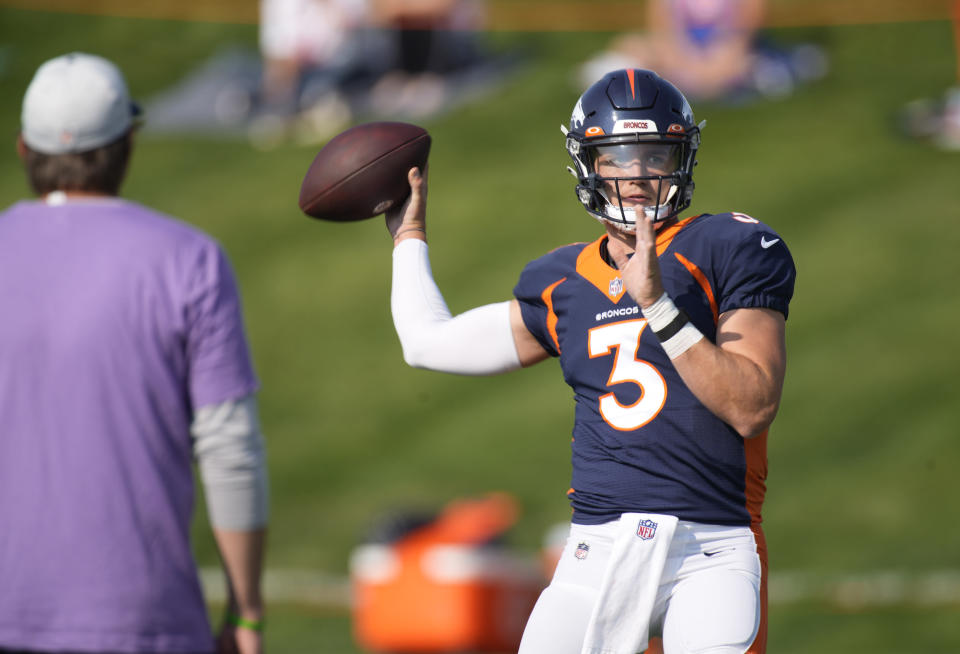 Denver Broncos quarterback Drew Lock looks to pass the ball while taking part in drills during an NFL football training camp at the team's headquarters Wednesday, Aug. 18, 2021, in Englewood, Colo. (AP Photo/David Zalubowski)