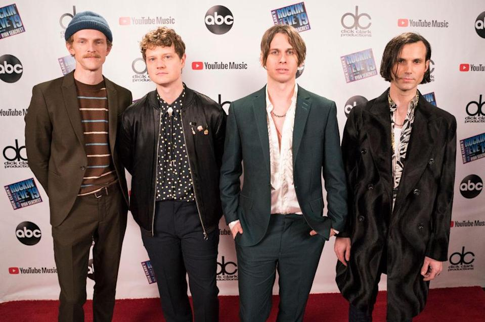 Photo of Foster the People on a music award show red carpet