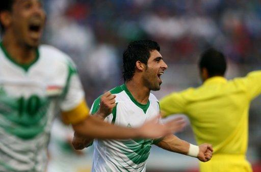 Iraq's Hammadi Ahmed Abdullah (R) and Younus Mahmood celebrate after scoring during a Gulf Cup match on January 9, 2013
