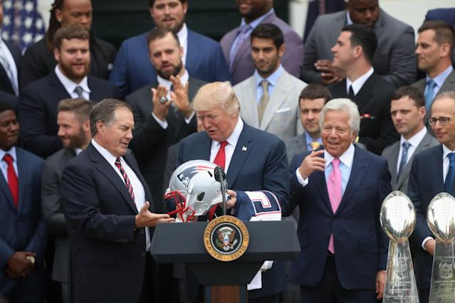 <p>New England Patriots head coach Bill Belichick presents President Donald Trump with a Patriots helmet during a ceremony on the South Lawn of the White House in Washington, Wednesday, April 19, 2017, where the president honored the Super Bowl Champion New England Patriots for their Super Bowl LI victory. Patriots owner Robert Kraft is at right. (AP Photo/Andrew Harnik) </p>