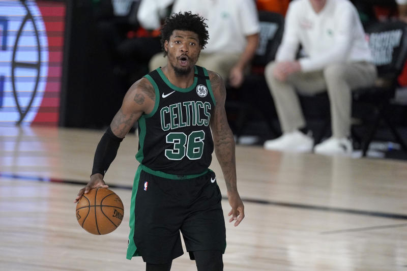 Boston Celtics' Marcus Smart (36) instructs the offense during the second half of an NBA conference final playoff basketball game against the Miami Heat on Tuesday, Sept. 15, 2020, in Lake Buena Vista, Fla. (AP Photo/Mark J. Terrill)