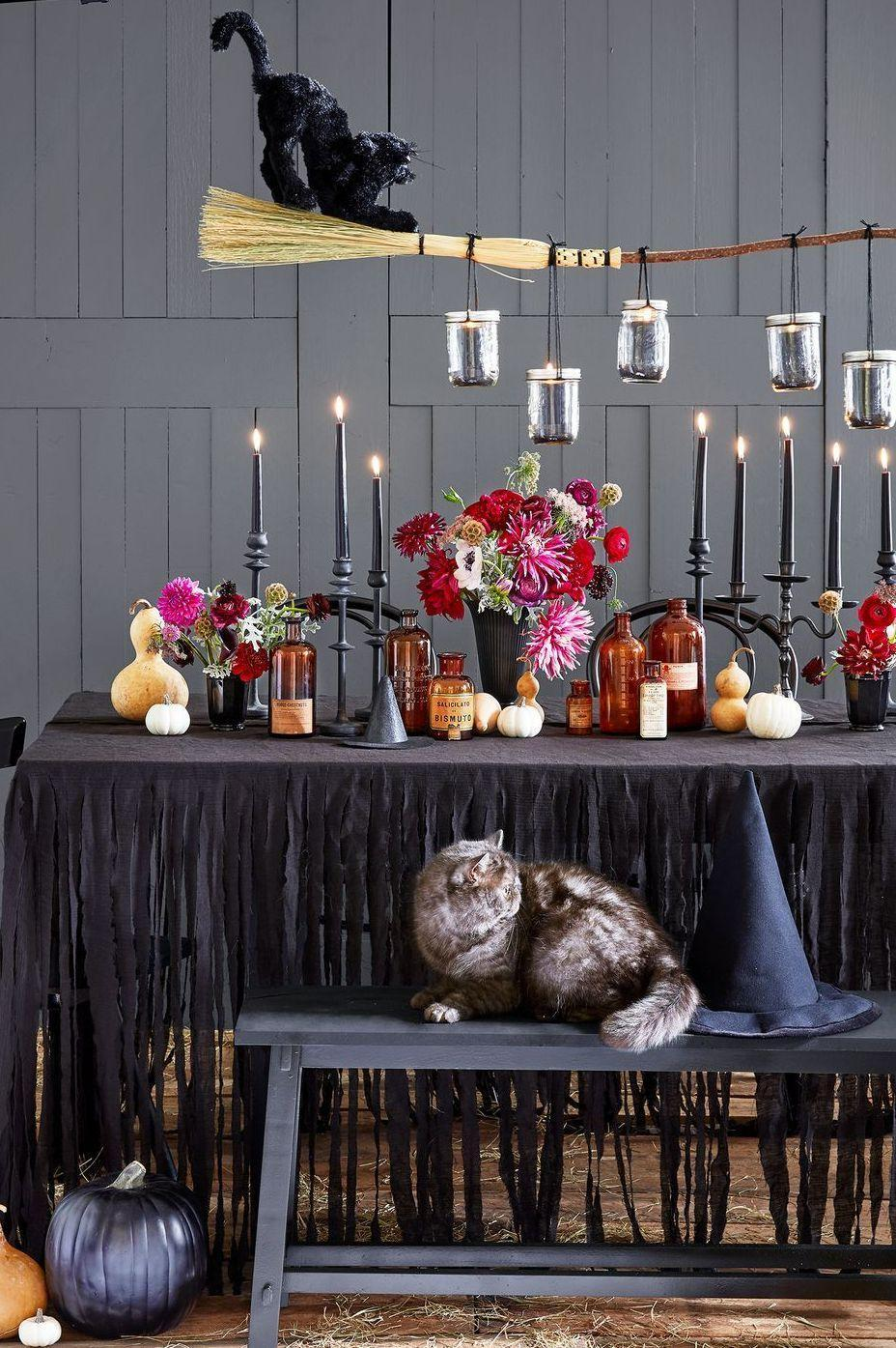 """<p>When it comes to <a href=""""https://www.goodhousekeeping.com/holidays/halloween-ideas/g421/halloween-decorating-ideas/"""" rel=""""nofollow noopener"""" target=""""_blank"""" data-ylk=""""slk:Halloween decorating ideas"""" class=""""link rapid-noclick-resp"""">Halloween decorating ideas</a>, nothing is off limits. The more, the better is the way to go. If that's your style, the best place to start is with your Halloween table decor. Your dining table is the blank canvas you need to express your creativity, whether it's with <a href=""""https://www.goodhousekeeping.com/holidays/halloween-ideas/g1714/no-carve-pumpkin-decorating/"""" rel=""""nofollow noopener"""" target=""""_blank"""" data-ylk=""""slk:loads of pumpkins"""" class=""""link rapid-noclick-resp"""">loads of pumpkins</a>, autumn flowers and stylish candlesticks, or on the opposite end of the Halloween decor spectrum, a ghoulish setup filled with spider webs, skulls and ghosts. </p><p>Browse these 40 creative Halloween decor ideas to bring your table to life. These <a href=""""https://www.goodhousekeeping.com/holidays/halloween-ideas/g421/halloween-decorating-ideas/"""" rel=""""nofollow noopener"""" target=""""_blank"""" data-ylk=""""slk:one-of-a-kind DIY pointers"""" class=""""link rapid-noclick-resp"""">one-of-a-kind DIY pointers</a> are full of inspiration to make your <a href=""""https://www.goodhousekeeping.com/holidays/halloween-ideas/g565/halloween-party-ideas/"""" rel=""""nofollow noopener"""" target=""""_blank"""" data-ylk=""""slk:Halloween celebration"""" class=""""link rapid-noclick-resp"""">Halloween celebration</a> gathered around a table a fun-filled one.<br></p>"""