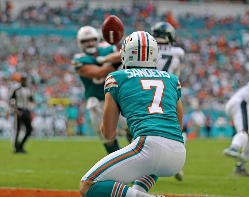 Miami Dolphins punter Matt Haack (2) tosses the ball to kicker Jason Sanders to score late in the second quarter as they play the Philadelphia Eagles at Hard Rock Stadium Sunday, Dec. 1, 2019 in Miami Gardens, Fla. The Dolphins won, 37-31. (Charles Trainor Jr./Miami Herald/Tribune News Service via Getty Images)