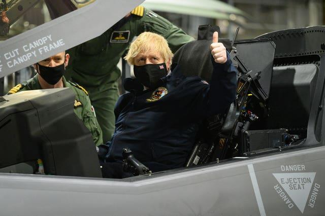 Prime Minister Boris Johnson sits in the cockpit of an Lockheed Martin F-35 Lightning II during his trip to Portsmouth on Friday