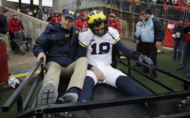 "Michigan quarterback <a class=""link rapid-noclick-resp"" href=""/ncaaf/players/263464/"" data-ylk=""slk:Brandon Peters"">Brandon Peters</a> is taken off the field on a cart during the second half of an NCAA college football game against the WisconsinSaturday, Nov. 18, 2017, in Madison, Wis. (AP Photo/Morry Gash)"