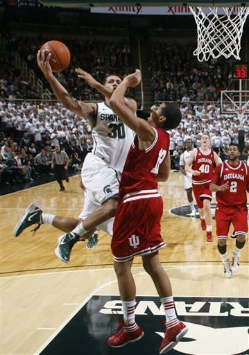 Michigan State's Brandon Wood (30) puts up a layup on a fast break against Indiana's Verdell Jones III (12) as Indiana's Christian Watford (2) and Cody Zeller (40) trail during the first half of an NCAA college basketball game on Wednesday, Dec. 28, 2011, in East Lansing, Mich. Michigan State won 80-65. (AP Photo/Al Goldis)