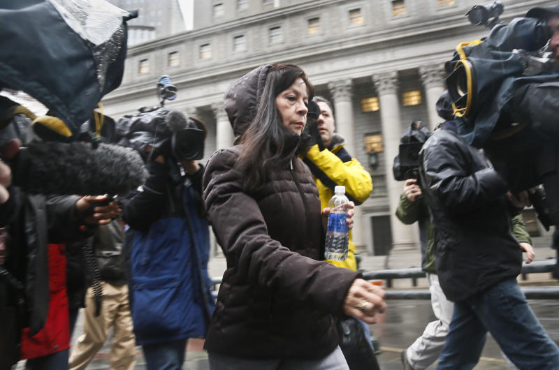 """Elizabeth Valle is surrounded by news reporters as she leaves court on Tuesday, March 12, 2013 in New York. A federal jury convicted her son, New York City police officer Gilberto Valle, of charges he plotted to kidnap and cook women to dine on their """"girl meat."""" Valle, 28, faces up to life in prison when he is sentenced on June 19. With the conviction, he loses his job as a police officer. (AP Photo/Bebeto Matthews)"""