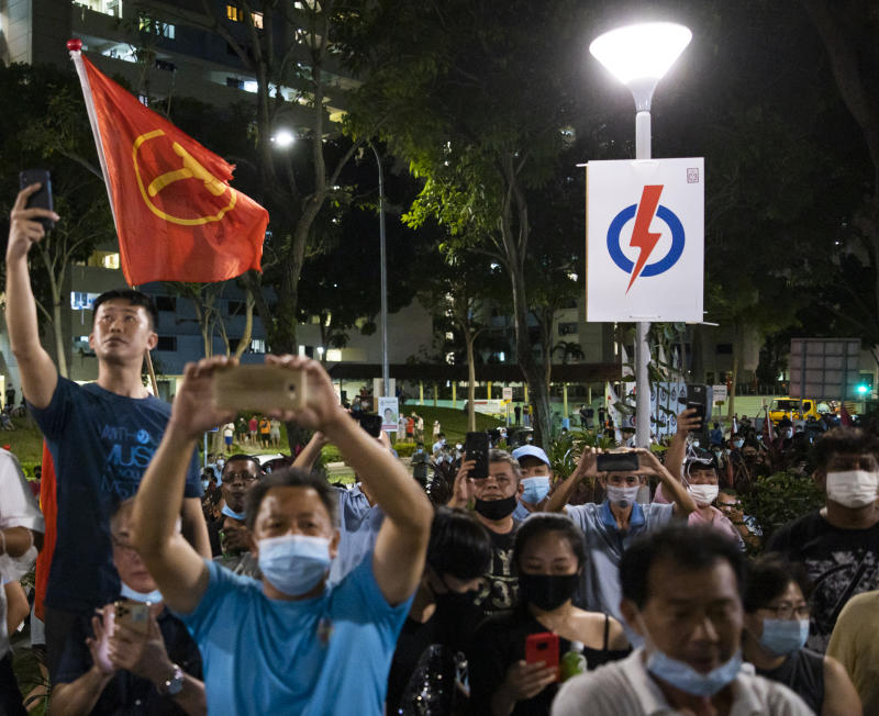 Residents gathering at Hougang Avenue 5 in the early hours of 11 July, 2020, hours after the GE2020 polls have ended. (PHOTO: Don Wong/Yahoo News Singapore)