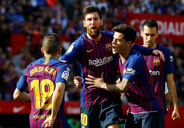 "<a class=""link rapid-noclick-resp"" href=""/soccer/players/372884/"" data-ylk=""slk:Lionel Messi"">Lionel Messi</a> is mobbed by his <a class=""link rapid-noclick-resp"" href=""/soccer/teams/barcelona/"" data-ylk=""slk:Barcelona"">Barcelona</a> teammates after scoring an amazing opening goal against <a class=""link rapid-noclick-resp"" href=""/soccer/teams/sevilla/"" data-ylk=""slk:Sevilla"">Sevilla</a>, his first of three in the 4-2 win. (Reuters/Marcelo del Pozo)"