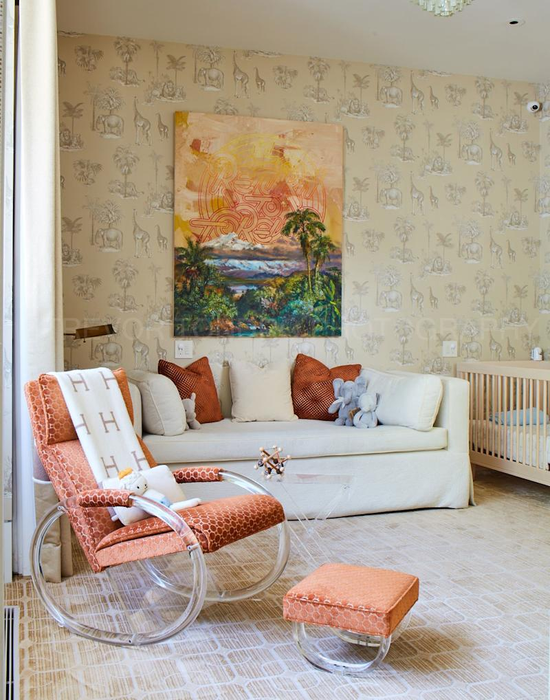 In the Williamses' son's nursery, the couple and Kravitz chose a more muted palette, accented by 1970s-inspired orange. A vintage Charles Hollis Jones rocking chair is paired with an oil painting by German artist Friedrich Kunath.