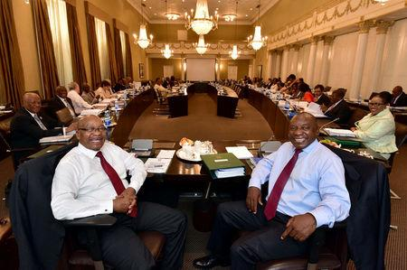 South African President Jacob Zuma and Deputy President Cyril Ramaphosa are seen attending Cabinet Committee meetings in this government handout