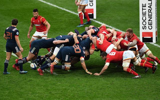 <span>The game ends in farce after a succession of reset scrums</span> <span>Credit: GABRIEL BOUYS/AFP/Getty Images </span>
