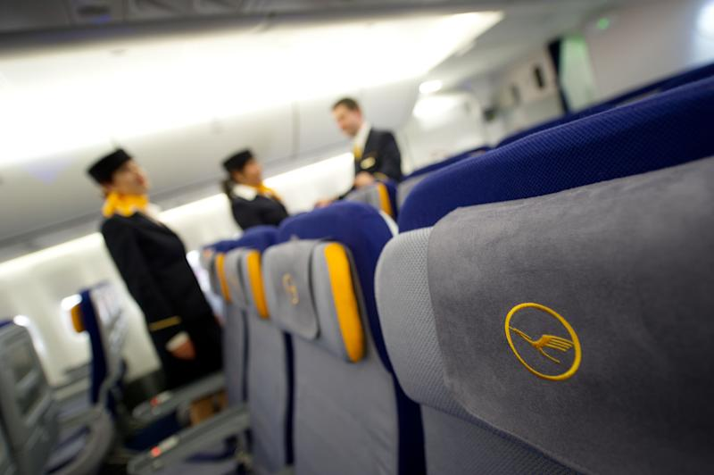 FILE - In this May 2, 2012 file photo, Lufthansa cabin personnel work in a Boeing 747-8 plane at the airport in Frankfurt. The arbitrator in a wage dispute between Germany's biggest airline Lufthansa and its flight attendants says the sides have reached a deal, averting the possibility of widespread strikes during the holiday season. Arbitrator Bert Ruerup said details of the deal would be announced later Tuesday Nov. 13, 2012. The UFO union was pushing for a 5 percent wage increase over 12 months for the 19,000 cabin personnel, while the airline was offering 3.5 percent over 36 months.   (AP Photo/dapd/Thomas Lohnes,File)