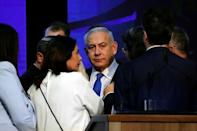 Israeli Prime Minister Benjamin Netanyahu looks on after speaking to supporters at his Likud party headquarters following the announcement of exit polls during Israel's parliamentary election in Tel Aviv, Israel