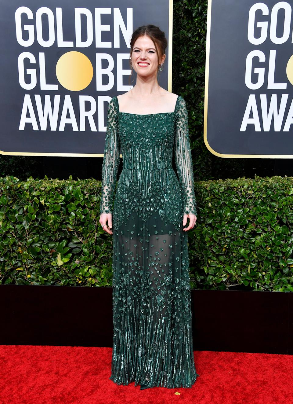 Very art deco in a way that's super appealing. But we'd love to see her hair down — that colour would look incredible with this emerald dress.