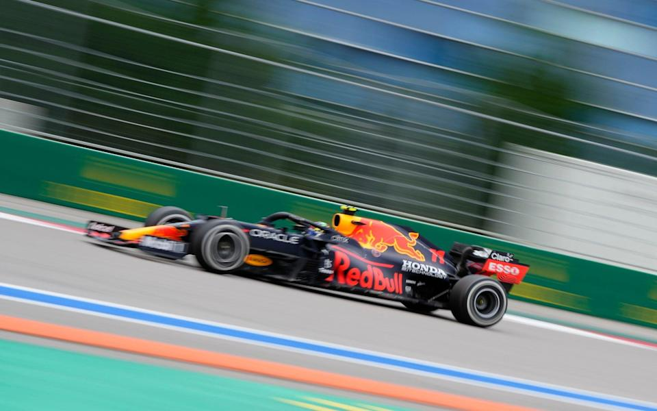 Red Bull driver Sergio Perez of Mexico steers his car during the Russian Formula One Grand Prix at the Sochi Autodrom circuit, in Sochi, Russia, Sunday, Sept. 26, 2021 - AP