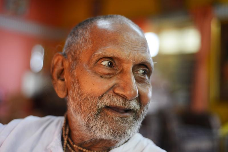 Indian monk Swami Sivananda whose passport lists his birth year as 1896, making him 123 years old.