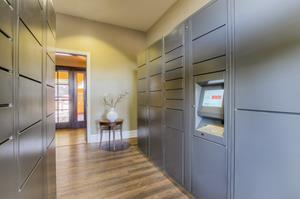 Parcel Pending by Quadient parcel locker in a residential building hall.
