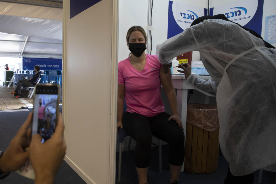An Israeli woman receives a Pfizer-BioNTech coronavirus vaccine at a COVID-19 vaccination center in Tel Aviv, Israel on Feb. 2, 2021. (Sebastian Scheiner/AP)