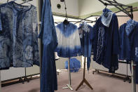 In this image from video, several clothes dyed by members of indigo dye group Japan Blue are displayed at a community center where residents evacuated when the big quake hit the area 10 years ago in Minamisoma, Fukushima Prefecture, northeastern Japan, on Feb. 20, 2021. After the Fukushima nuclear plant disaster a decade ago, nearby farmers weren't allowed to grow crops for two years because of radiation. After the restriction was lifted, two farmers in the town of Minamisoma found an unusual way to rebuild their lives and help their destroyed community. Kiyoko Mori and Yoshiko Ogura planted indigo and soon began dying fabric with dye produced from the plants.(AP Photo/Chisato Tanaka)