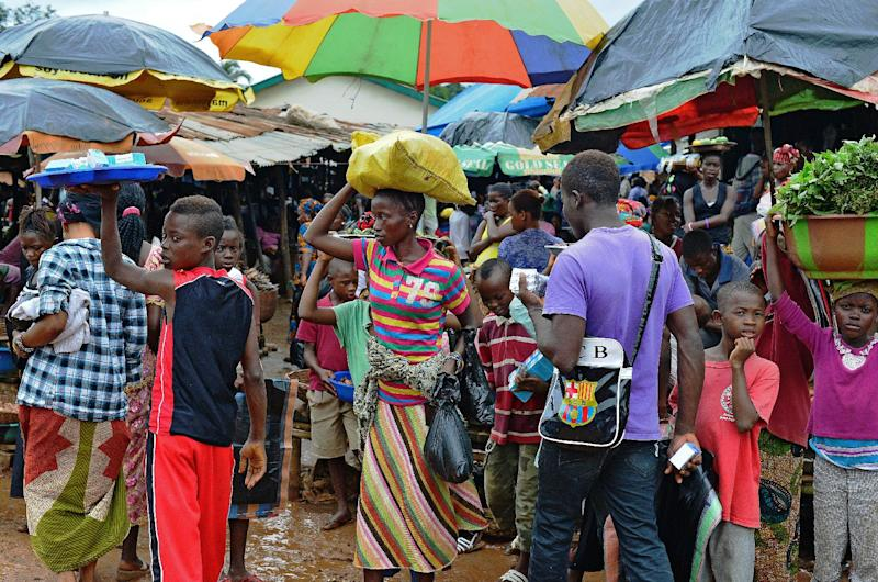 People walk in a market in Kenema, Sierra Leone, on August 16, 2014 (AFP Photo/Carl de Souza)