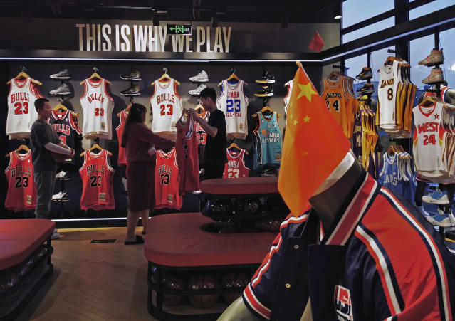 The Chinese flag is never far in the NBA's flagship retail store in Beijing. (Photo by Kevin Frayer/Getty Images)