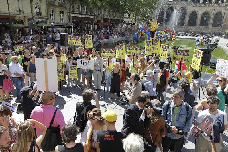 Demonstrators hold banners in support of the Russian punk group Pussy Riot during a protest in Paris Friday Aug. 17, 2012. Three members of Pussy Riot were jailed in March and charged with hooliganism motivated by religious hatred after their punk performance against President Putin in Moscow's main cathedral. They are awaiting the verdict later Friday, Aug. 17, 2012. (AP Photo/Jacques Brinon)