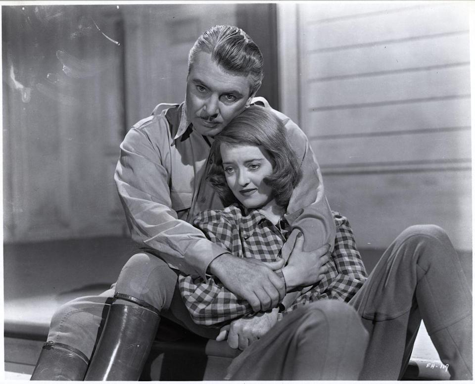 <p>Davis and her male co-star George Brent in a scene from the 1941 Warner Brothers drama <em>The Great Lie</em>.</p>