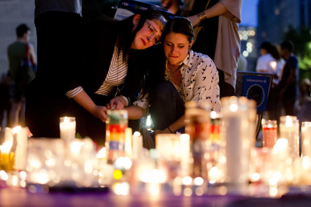 <p>People gather for a vigil in memory of the victims of the Orlando mass shooting, on Monday, June 13, 2016, at City Hall in Philadelphia. A gunman opened fire inside a crowded gay nightclub early Sunday, before dying in a gunfight with SWAT officers, police said. (Photo: Matt Rourke/AP) </p>