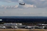 FILE PHOTO: A British Airways aircraft takes off over terminal 4 at Heathrow Airport near London