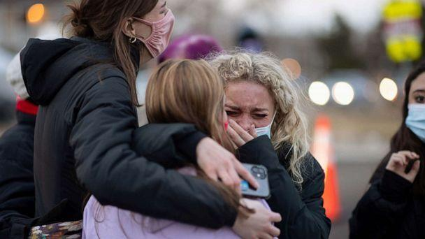 PHOTO: Josie Elowsky cries and hugs her friend, Nirbisha Shetsha, at the site of a mass shooting at King Soopers grocery store in Boulder, Colo., March 23, 2021. (Alyson Mcclaran/Reuters)
