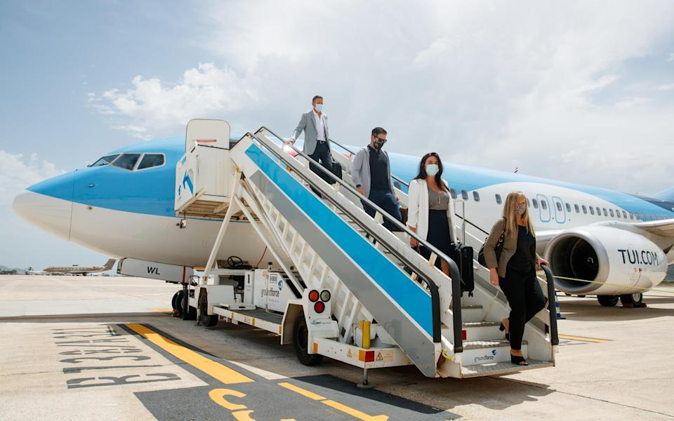 Passengers alighting TUI's first flight after lockdown