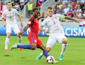 Slovakia's Martin Skrtel, right, challenges for a ball against England's Raheem Sterling during their World Cup Group F qualifying soccer match in Trnava, Slovakia on Sunday Sept. 4, 2016. (AP Photo/Bundas Engler)