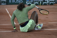 United States Serena Williams gets after slipping on the clay court as she plays against omania's Irina-Camelia Begu during their first round match on day two of the French Open tennis tournament at Roland Garros in Paris, France, Monday, May 31, 2021. (AP Photo/Michel Euler)