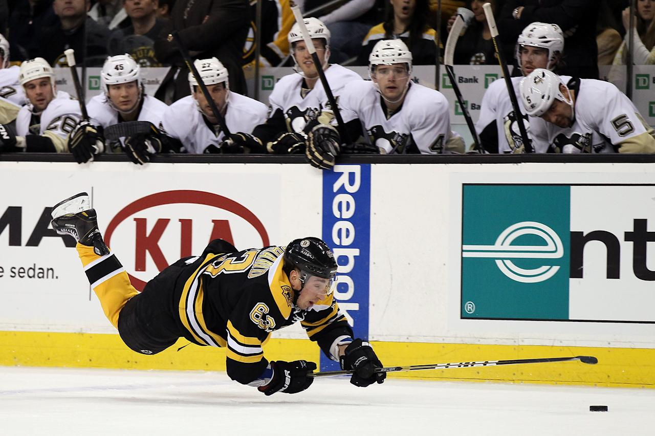 BOSTON, MA - APRIL 03:  Brad Marchand #63 of the Boston Bruins trips as he tries to hang on to the puck against the Pittsburgh Penguins on April 3, 2012 at TD Garden in Boston, Massachusetts.  (Photo by Elsa/Getty Images)