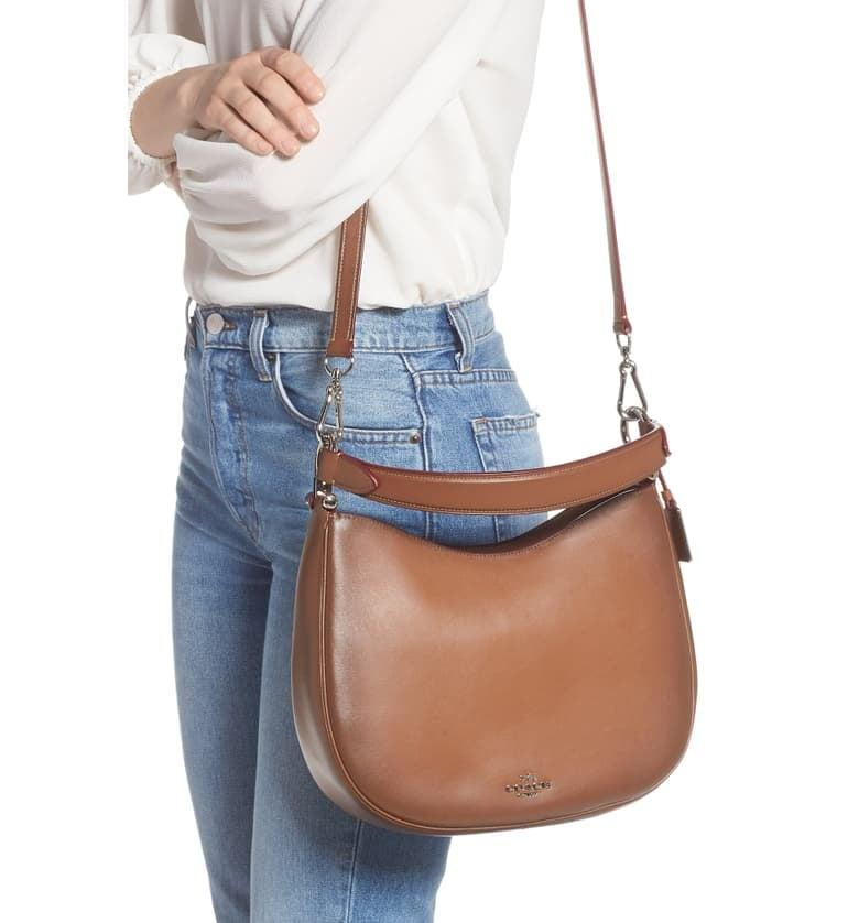 """<p>You can't go wrong with this classic <a href=""""https://www.popsugar.com/buy/Coach-Nomad-Burnished-Leather-Crossbody-Bag-467247?p_name=Coach%20Nomad%20Burnished%20Leather%20Crossbody%20Bag&retailer=shop.nordstrom.com&pid=467247&price=264&evar1=fab%3Aus&evar9=46246173&evar98=https%3A%2F%2Fwww.popsugar.com%2Ffashion%2Fphoto-gallery%2F46246173%2Fimage%2F46371591%2FCoach-Nomad-Burnished-Leather-Crossbody-Bag&list1=shopping%2Cnordstrom%2Csale%2Csale%20shopping%2Cnordstrom%20sale%2Cnordstrom%20anniversary%20sale&prop13=api&pdata=1"""" rel=""""nofollow"""" data-shoppable-link=""""1"""" target=""""_blank"""" class=""""ga-track"""" data-ga-category=""""Related"""" data-ga-label=""""https://shop.nordstrom.com/s/coach-nomad-burnished-leather-crossbody-bag/5270844?origin=category-personalizedsort&amp;breadcrumb=Home%2FAnniversary%20Sale%2FWomen%2FHandbags%20%26%20Accessories%2FHandbags%20%26%20Wallets&amp;color=saddle"""" data-ga-action=""""In-Line Links"""">Coach Nomad Burnished Leather Crossbody Bag</a> ($264, originally $395).</p>"""
